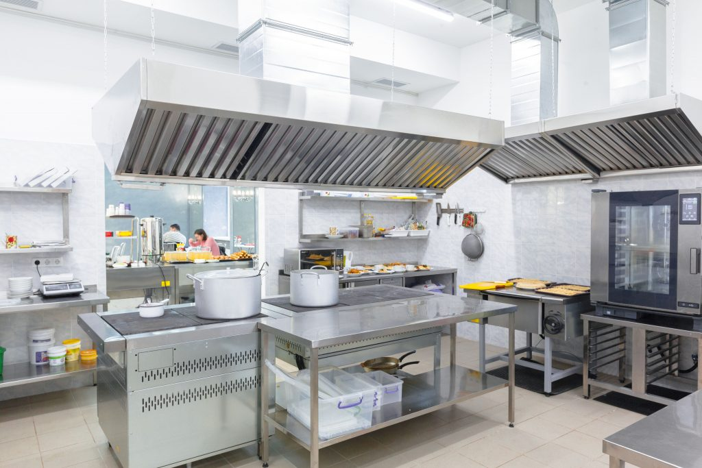indoor commercial kitchen with stainless steel appliances